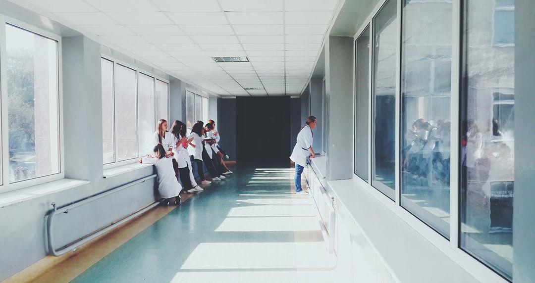 people in hospital corridor